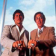 Plunkett and Tom Flores showing off their Super Bowl rings.